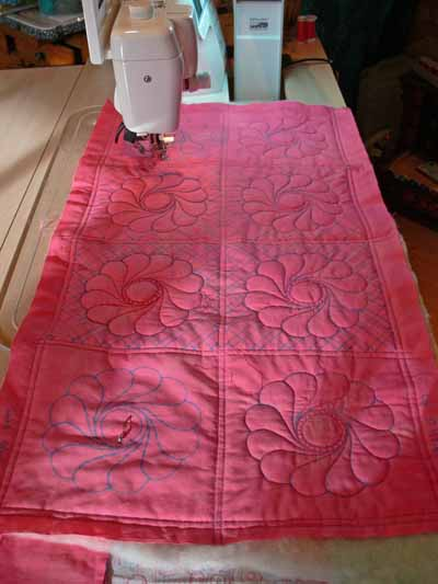 Coral Background Quilting Sampler while being stitched