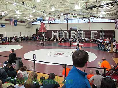 The Meet is large:  four mats going at once to get through the 300+  wrestlers on Day One.