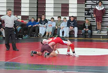 Eli is in red.  The LaSalle boy has his arms in control, so Eli is arching up to keep from getting pinned.  He managed that, losing only 5-7.