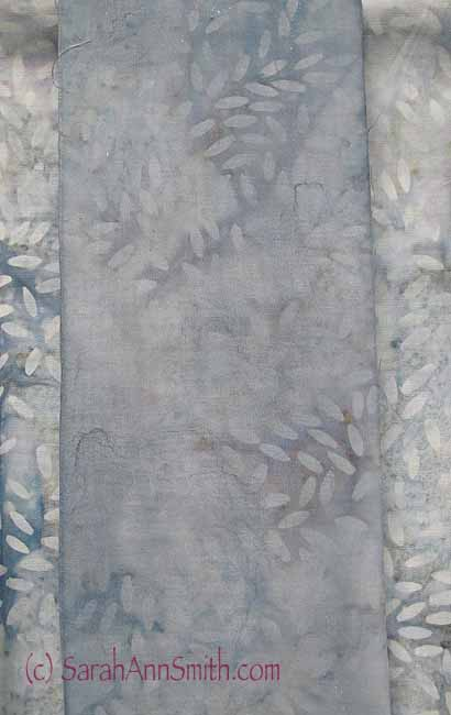 "And a lighter wash on the ""rice grain"" gray batik.  As the cloth came from the bolt it is too bright, too distracting.  This muted over paint is just right!"