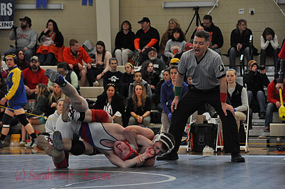 Eli is in back and in control as he takes his opponent down to the mat to attempt to pin him.