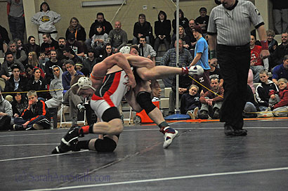 In the finals match, Connor wrestled one of the best wrestlers in the state, senior Daniel DelGallo from Gardiner. DelGallo is now a three-time state champion, but Connor wasn't going to make his trip to the top of the stand easy! That's Connor in front, yanking DelGallo off his feet.