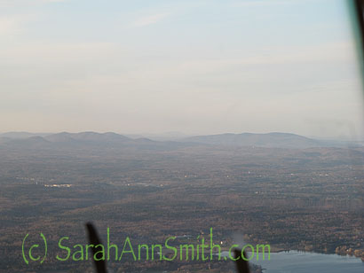There are two landmarks visible from the sky from a distance.  I was in the seat behind the co-pilot's seat (which is usually filled with a passenger).  The first are the Camden Hills:  Battie, Megunticcok, Maidencliff.