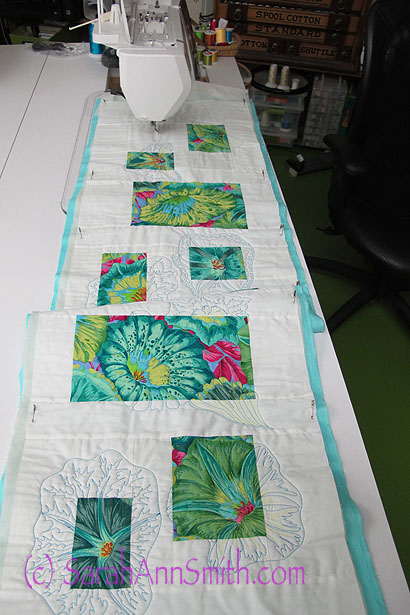 Having fun with a lovely floral, colorful thread, and quilting!