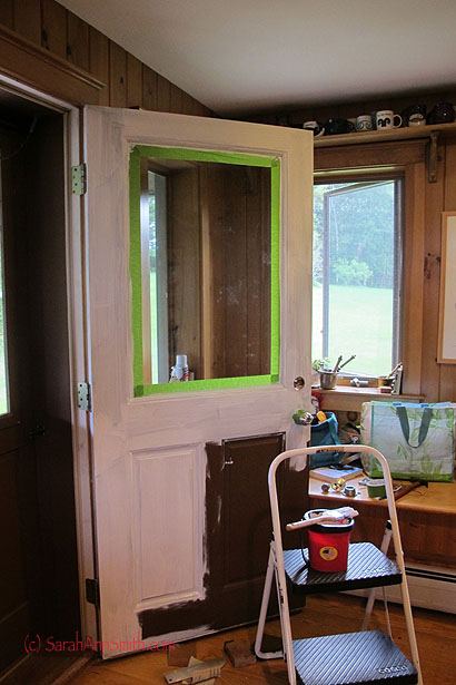 The formerly dark brown (lower right corner) door is primed and ready to be painted!
