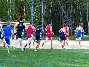As the leaders went past me at the start, and nearly where they ended up:  Ben T. (senior) in the lead, Caleb (freshman) and Eli (sophomore).  Ben W. isn't in this picture, but he was able to avoid getting boxed in and finished in the top ten for the first time this season!