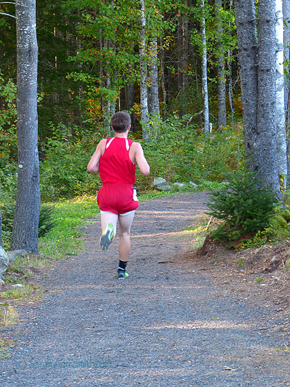 The essence of Cross Country:  running through the Maine woods, here near the Medomak middle and high school fields.  That is, of course, Eli!