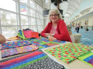 Jamie at Quilt Market getting a first look at her fabric line!  How cool is that?