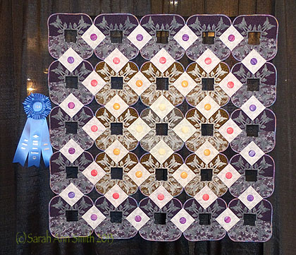 And here's to the Maine contingent!  My friend Pat LaPierre McAfee, of Supreme Slider fame, is a top quilter.  She won (another!) first place ribbon for this beautiful work.