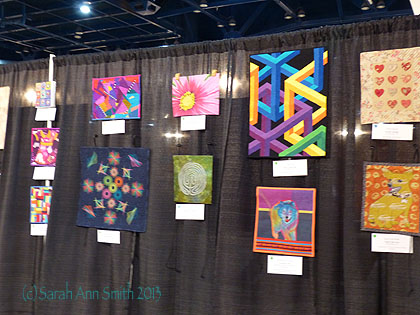 A few of the Silent Auction quilts, including my little green one.