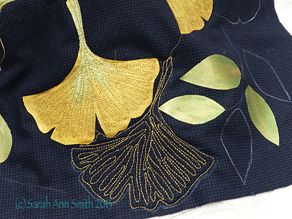 This student chose gingko leaves pointing away from the center on the north-south/east-west axes. She then penciled in quilting guidelines on the black background.