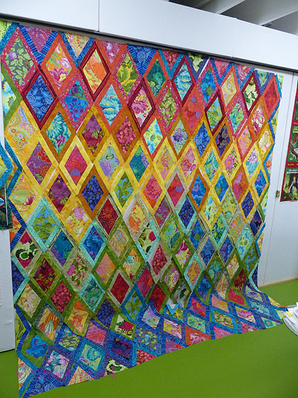 Inspired by Kaffe Fassett's diamonds quilts.  I used the diamond template I had, then cut strips to make 1 inch (finished) sashing/borders for each diamond.  There are not two pairings the same in the entire quilt.  Doesn't the color just make you happy?  Now to get it pieced without messing up the order!