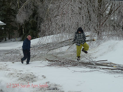 A day or two ago (they are running together already!) Paul and Eli (the latter in jammy pants, flannel shirt, new heavy boots and Elmer Fudd hat) moved broken branches so Alex's plow won't have trouble.