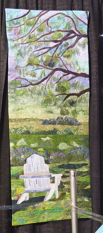 Diane Perin Hock's portrait of the Adirondack chair under the tree at a quilt retreat fill me with calm.  The colors, the serenity...I love this!