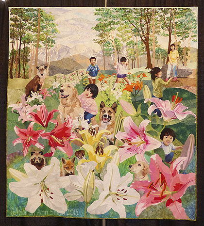 A much larger quilt (I'd guess at least 60 inches) by Hiroko Miyama and Masanobu Miyama.  Do you see the Golden with the little boy?