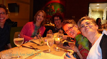 One of the two tables of folks in the Dinner@8 exhibit.  Leslie is at the head of the table, next to Diane Rusin Doran (in pink), Susan Brubaker Knapp (glasses) and Lyric Kindard (only partly in the photo--sorry Lyric!)