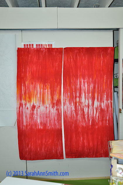 The resulting red fabrics used on the front (and back) of the quilt.