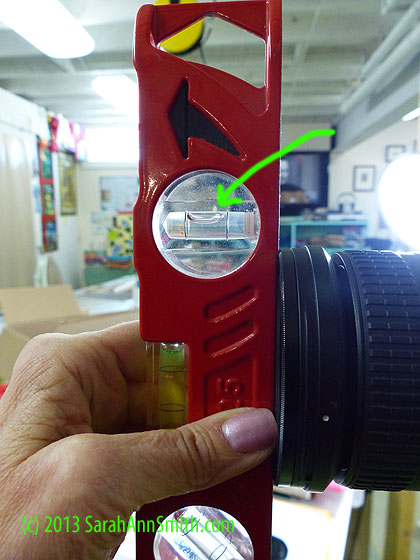 use  your Torpedo or other level to make sure the front of the lens is vertical.  A larger level such as this one is likely to have a bit better accuracy than a small one like the hotshoe level.  It also means I don't have to jar the camera taking the hotshoe level in and out of the hotshoe!