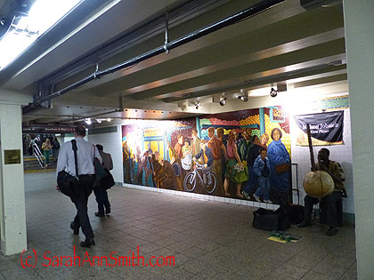 In the subway, a mural and music