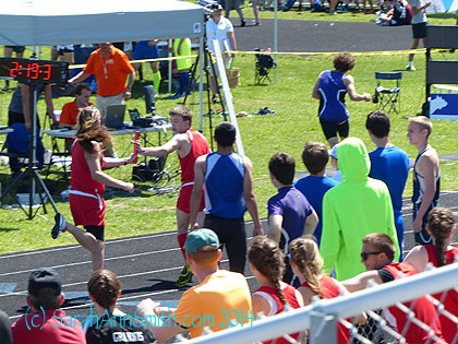 The end of the year insanity began with States in Cross Country.  Here's Eli receiving the baton in the 4 x 800 m. relay