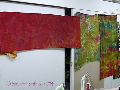 Here are some fabrics in the deep values:  greens with berry and a deep burgundy.