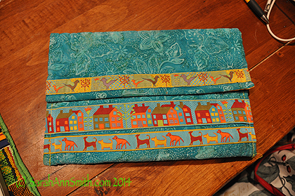 The iPad case is simply a larger version of the card holder.  The trim comes from Renaissance Ribbons.