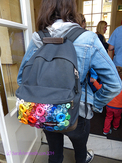 Never one to miss a sewing opportunity or idea, however, I snapped this young woman's backpack with button pocket while at the baths.