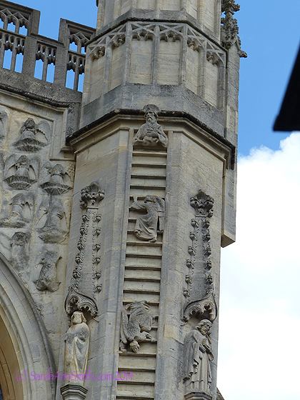 On one of the towers of the Cathedral.  Note most of the angels are going up, but one is falling.