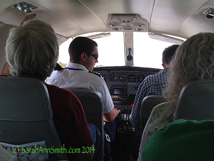 """Some years ago I wrote a blogpost titled """"This is not a minivan.""""  It is still not a minivan:  this is the view from the inside of the 9 passenger prop plane we take (Cape Air, love them!) to Boston, from which point we can get anywhere in the world."""