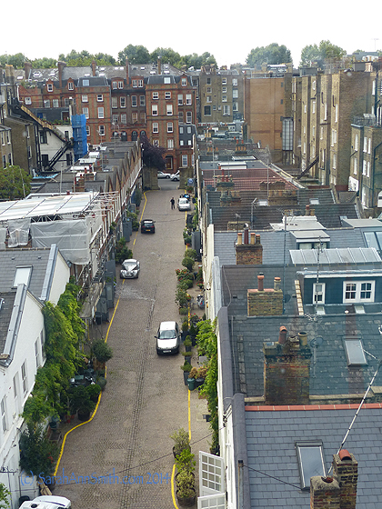 The view of the alley behind our hotel in the Gloucester Road/South Kensington  part of London.  Notice the silver car on the left.