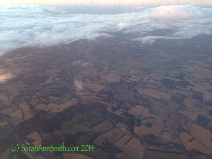 The fields and hedgerows of England on the approach to London.  A bit more countryside!