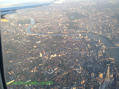 As the plane ducked under the cloud cover we got a spectacular aerial view of London, with the Thames, South Bank on the Left, more of the mass of London on the right, The London Eye (the big ferris wheel), Parliament, Big Ben, the Tower, and so much more in clear view