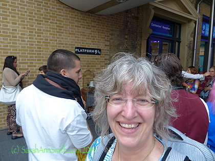 Me, with some of the crowd behind me and the Platform sign barely visible.  Happy to be there anyway!
