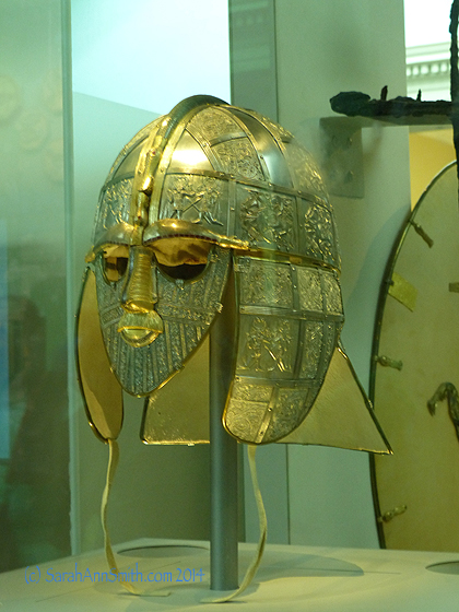 Based on the fragments and knowledge about contemporary helmets and design, they have made this piece to show what it would have looked like at the time of burial, including the garnets on the eyebrow ridges.  Simply phenomenal artistry and craftsmanship.