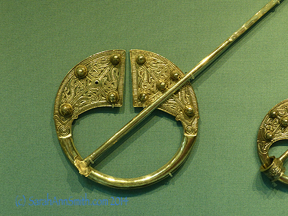 Just LOOK at this amazing ring pin; this one is probably almost 4 inches in diameter, and that pin could be lethal!