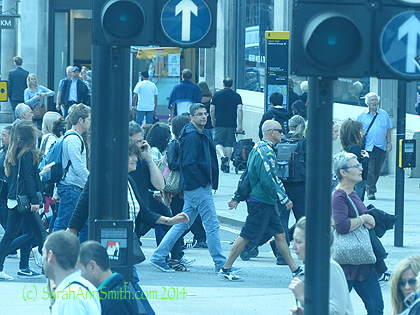 """I wish I had thought to switch the camera over to video, here on Regent Street at Oxford Circus.  A """"Circus"""" is a roundabout or traffic circle.  This was about 10 am on a Tuesday  morning.  Talk about a swarm of humanity...it made me laugh, and really glad I was on the bus and not IN the swarm!"""