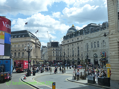 Coming up on Picadilly Circus, traveling on Regent Street.  Notice the done on the building on the corner.