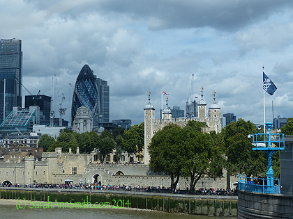 The old and the new:  the Tower of London (another place we regretfully decided to skip because it was wall-to-wall people), with the modern building called the Gherkin behind it.
