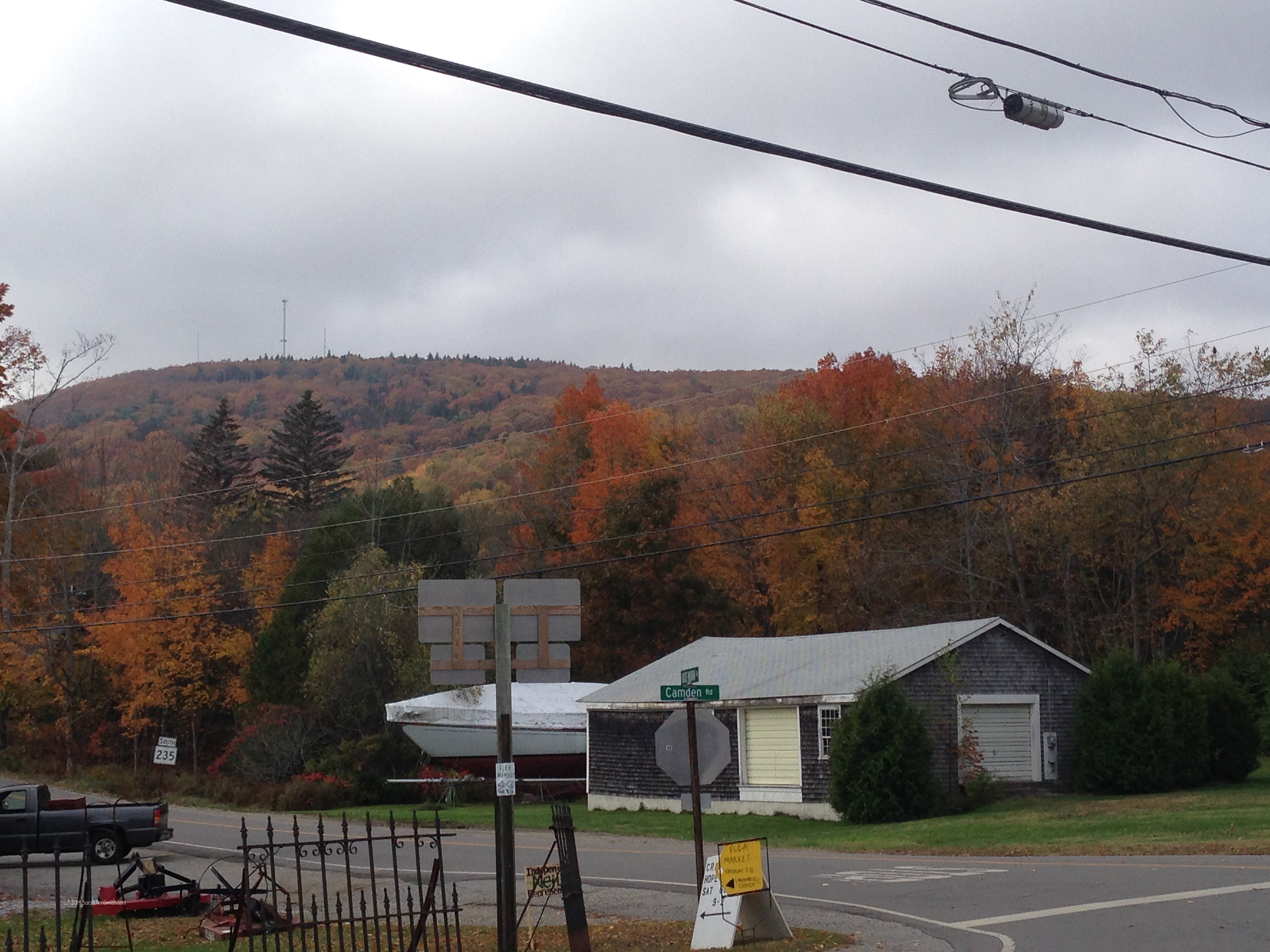 Hatvhet Mountain as seen from in front of the Hope General Store.  Hope, Maine.  Photo (c) Sarah Ann Smith