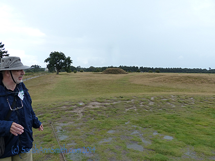 Our guide and some of the mounds in the burial grounds.