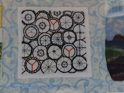 Another of the blocks from the Tour de France stitchery quilt.