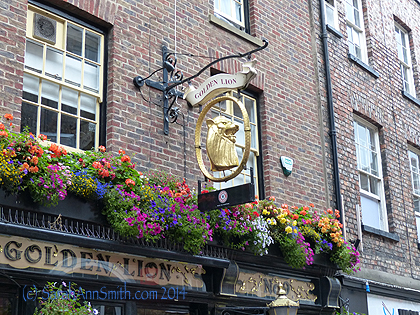 On the way to the minster, we passed yet another pub with glorious flowerboxes and a wonderful sign.