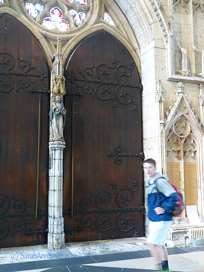 The inside of the big doors on the West face of the Minster and Eli, not so happy that I'm taking yet another  photo of him.  That's what moms do, kiddo!