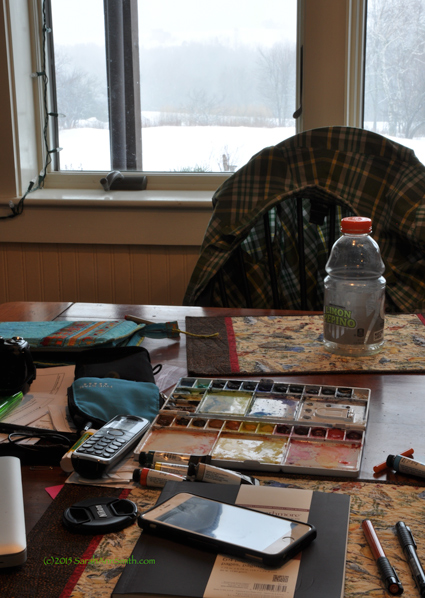 "This shot was (duh) indoors, before I went out.  I think of this as ""chaos, clutter, artist at work.""  I've also taken some sketchbook courses online over the past year, and am learning to work more with watercolors.  I want to loosen up, have my art quilts be a bit more spontaneous (well, everything in my life pretty much could benefit from me being less of a control-freak)."