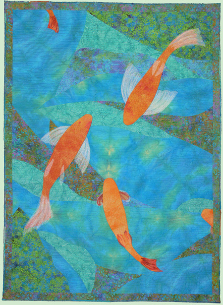 Koi is actually a two-sided quilt.  This photo was taken before adding the hanging sleeve to the top of the back (imagine lying on the bottom of the koi pond looking up at the fish bellies and the trees above)