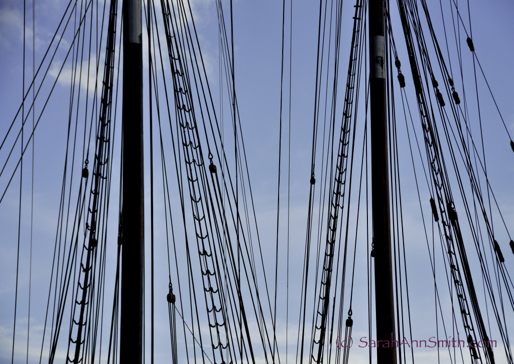 adjusted levels to darken the masts, smart sharpen.  Lightened the sky by adjusting the blues slightly.  Slightly cropped on the right. The Bluenose II, a replica of the Bluenose which is on the back of the Canadian dime.  Lunenburg, Nova Scotia.  I liked the play of lines across the image.