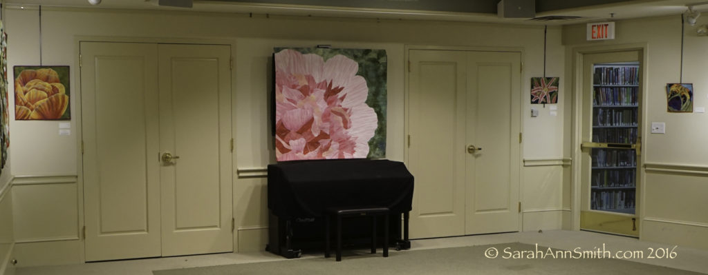 The far wall has two small pieces and my newest, the Peony. The center is challenging to hang, since there is a TV behind the quilt that is used a couple times a month, but it is THE most eye-catching spot.