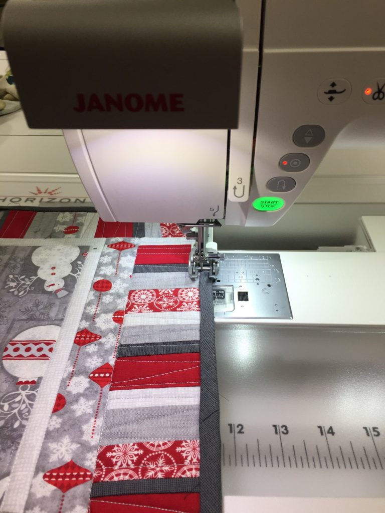 stitching down the bindings on the Janome 9400