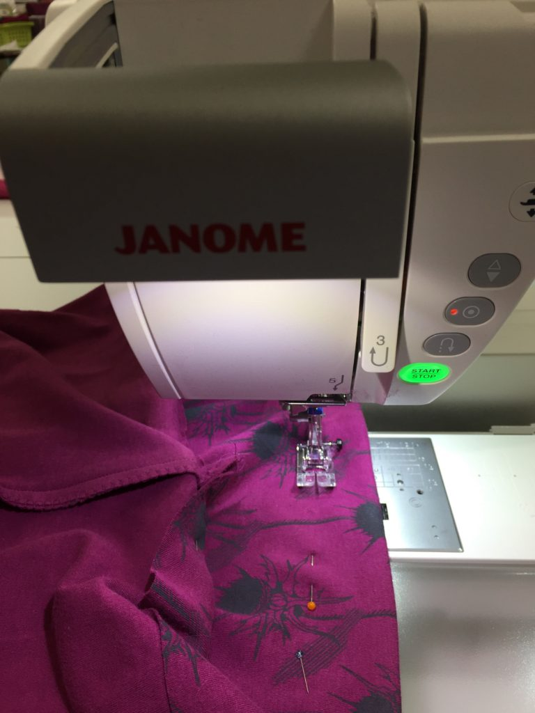 Sewing the hem. I am using a line on the throat place as a guide to create a gem that is about an inch deep.