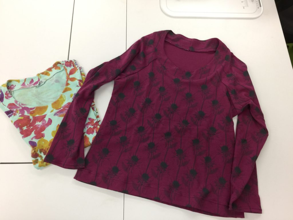 Success!  I actually made a KNIT garment.  The original shirt (purchased) is on the left. After making the pattern from that shirt, I made the plum one on the right.  I'll do a separate blogpost later this week with more info on how I did it and which stitches used.